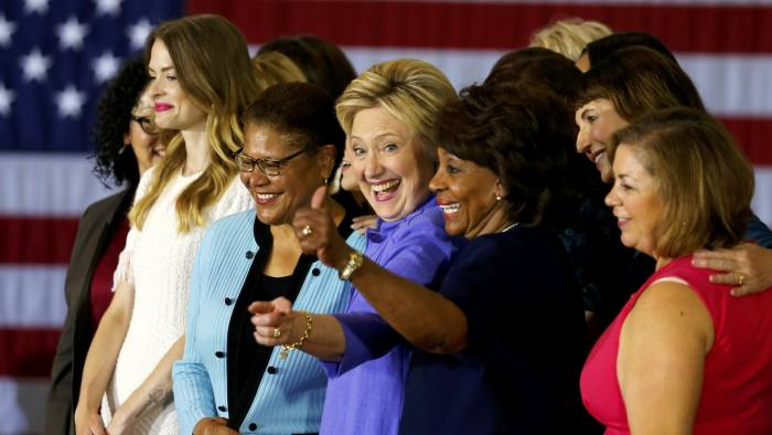 U.S. Democratic presidential candidate Hillary Clinton poses for a group picture on stage during an appearance at a