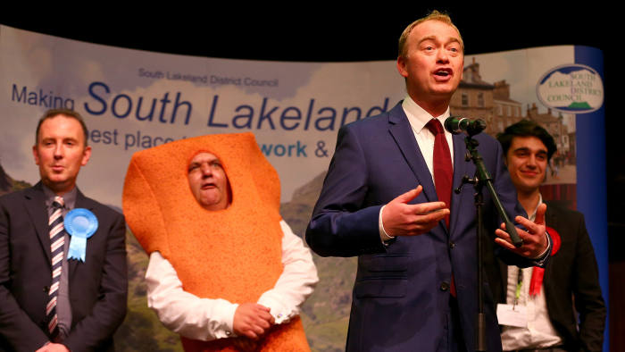 KENDAL, UNITED KINGDOM - JUNE 09: Leader of the Liberal democrats Tim Farron celebrates beating Conservative party candidate James Airey (L) Independent candidate Mr Fishfinger and Labour candidate Eli Aldridge (R) following the announcement of the results at the Westmoorland and Lonsdale constituency count at Kendal Leisure Centre on June 9, 2017 in Kendal, United Kingdom. After a snap election was called, the United Kingdom went to the polls yesterday following a closely fought election. The results from across the country are being counted and an overall result is expected in the early hours. (Photo by Dave Thompson/Getty Images)