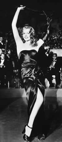 woman in shiny black strapless dress