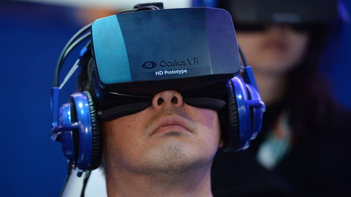 FILE - MARCH 25, 2014: According to reports, Facebook will acquire virtual realty tech company Oculus Rift for $2 billion. An attendee wears an Oculus Rift HD virtual reality head-mounted display at he plays EVE: Valkyrie, a multiplayer virtual reality dogfighting shooter game, at the Intel booth at the 2014 International CES, January 9, 2014 in Las Vegas, Nevada. AFP PHOTO /ROBYN BECK (Photo credit should read ROBYN BECK/AFP/Getty Images)