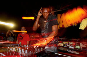 Bolt celebrating with a DJ set after his victories