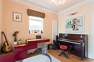 Piano in the sitting room where Rahman writes her music
