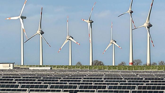 Wind turbines stand behind a solar power park on October 30, 2013 near Werder, German