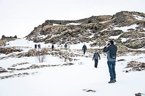 Visitors on the 'Game of Thrones' tour walking to a location near Lake Myvatn