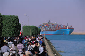A heavily laden Maersk ship in Port Said, Egypt, gateway to the Suez Canal