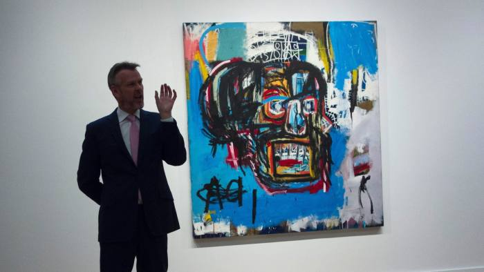A Sotheby's official speaks about an untitled painting by Jean-Michel Basquiat during a media preview May 5, 2017 at Sotheby's In New York.                            The piece is one of the creations to be auctioned during the Impressionist and Modern Art evening sale May 16, 2017 in New York / AFP PHOTO / Don Emmert        (Photo credit should read DON EMMERT/AFP/Getty Images)