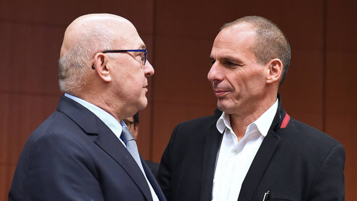 Greek finance minister Yanis Varoufakis, right, and French counterpart Michel Sapin
