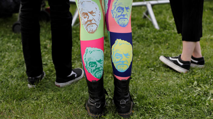 A woman wears tights showing the face of Jeremy Corbyn, leader of Britain's opposition Labour Party, at a campaign rally in Birmingham, Britain June 6, 2017. REUTERS/Darren Staples TPX IMAGES OF THE DAY