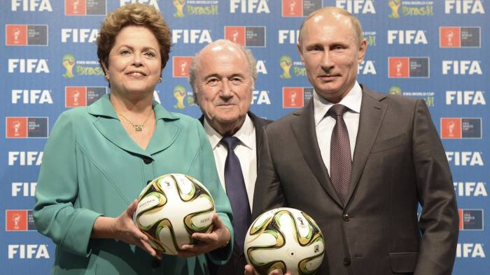 From left: Brazil's President Dilma Rousseff, FIFA President Sepp Blatter and Russia's President Vladimir Putin at the official hand over ceremony for the 2018 World Cup