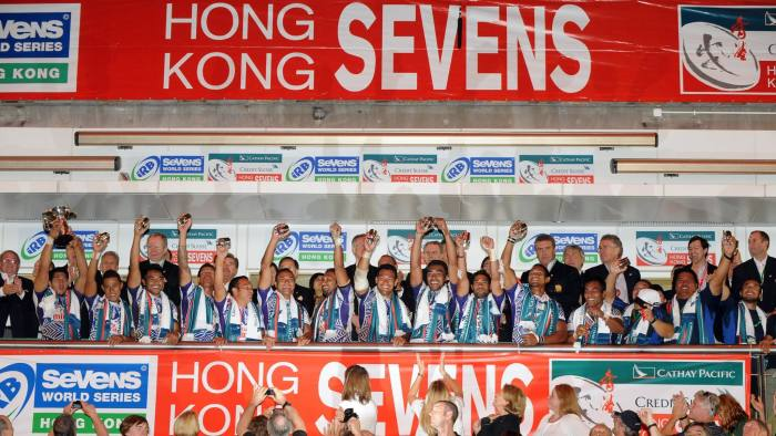 Members of the Samoa rugby sevens team (C) raise their hands to celebrate winning the cup on the final day of the Hong Kong Sevens rugby tournament on March 28, 2010. Samoa beat New Zealand 24-21 to take home the Hong Kong Sevens Cup, their third IRB World Sevens victory in a row after Adelaide and Vas Legas. AFP PHOTO/Ed Jones (Photo credit should read Ed Jones/AFP/Getty Images)