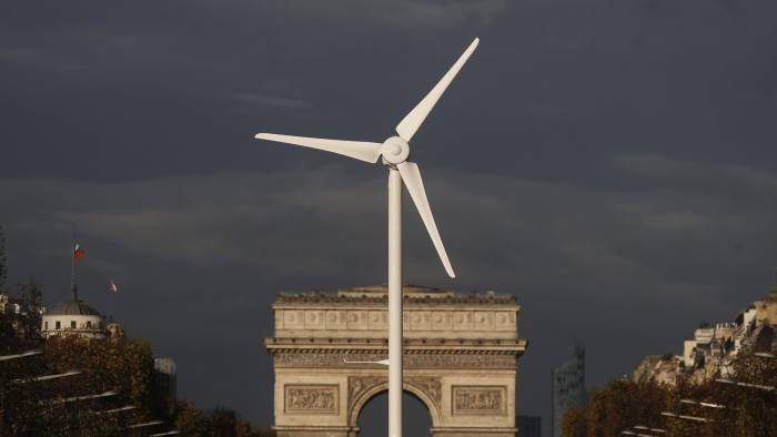 A power-generating windmill turbine is seen in front of the Arc de Triomphe on the Champs Elysees avenue in Paris ahead of the COP21 World Climate Summit, France, November 25, 2015. The upcoming conference of the 2015 United Nations Framework Convention on Climate Change (COP21) will start on November 30, 2015 at Le Bourget near the French capital. REUTERS/Christian Hartmann TPX IMAGES OF THE DAY