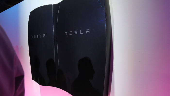 People look at newly-unveiled Tesla Powerwall batteries at the Tesla Design Studio in Hawthorne, California, April 30, 2015. Electric car pioneer Telsa Motors unveiled a