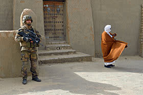 A French soldier stands guard in front of Timbuktu's Djingereyber mosque in January