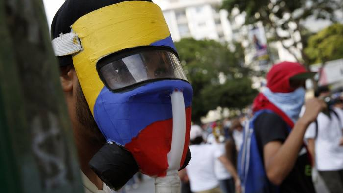 A demonstrator wears a homemade gas mask during a protest against the government of President Nicolas Maduro in Caracas