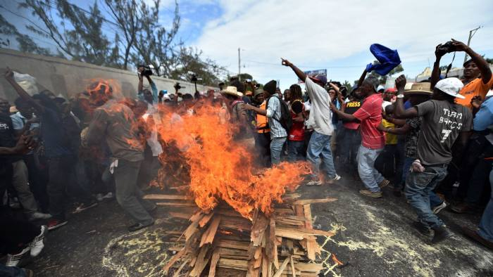Demonstrators perfom a voodoo ceremony prior a march, in Port-au-Prince, on January 22, 2016.  Demonstrators marched to protest against the presidential elections. Haiti's electoral authority has postponed Sunday's planned presidential run-off amid mounting opposition street protests and voting fraud allegations. The second round of presidential elections was scheduled for January 24 between ruling party candidate Jovenel Moise and Jude Celestin but was suspended by CEP. / AFP / HECTOR RETAMAL        (Photo credit should read HECTOR RETAMAL/AFP/Getty Images)