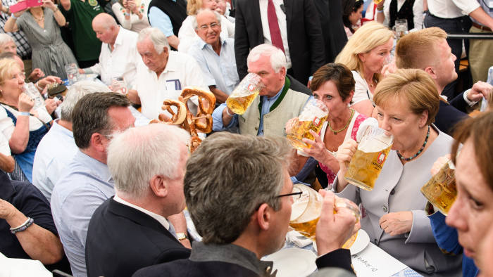 MUNICH, GERMANY - MAY 28: German Chancellor and Chairwoman of the German Christian Democrats (CDU) Angela Merkel drinks from a beer mug at the Trudering fest on May 28, 2017 in Munich, Germany. The CDU and CSU, along with the German Social Democrats (SPD), form the current German coalition government, though relations between Merkel and Seehofer have been complicated as the two have clashed over certain issues, especially immigration. (Photo by Sebastian Widmann/Getty Images)