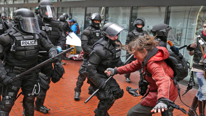 Protesters clash with police Monday, Feb. 20, 2017, in Portland, Ore. Thousands of demonstrators turned out Monday across the U.S. to challenge President Donald Trump in a Presidents Day protest dubbed Not My President's Day. (Dave Killen/The Oregonian via AP)