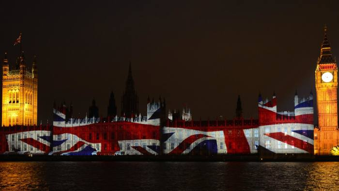 An image of the Union flag is projected on The Houses of Parliament in London on July 27, 2012, during the opening ceremony of the London 2012 Olympic Games. AFP PHOTO/ERIC FEFERBERG (Photo credit should read ERIC FEFERBERG/AFP/GettyImages)