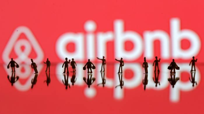 REFILE-CORRECTING GRAMMARA 3D printed people's models are seen in front of a displayed Airbnb logo in this illustration taken, June 8, 2016. REUTERS/Dado Ruvic/Illustration TPX IMAGES OF THE DAY