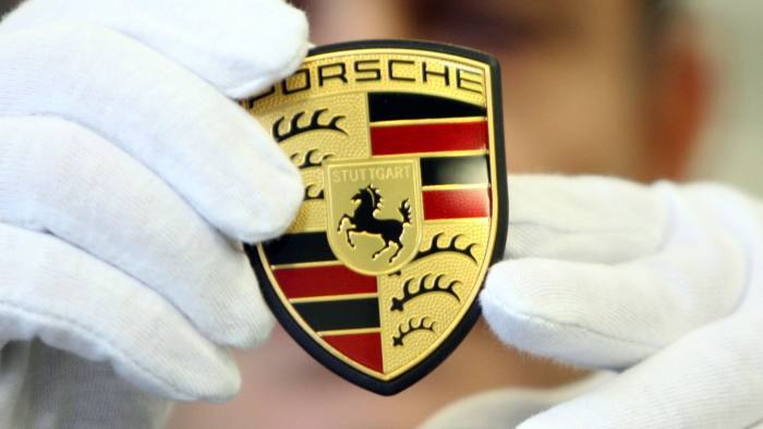 Porsche rewards staff for sales boom with record bonus ...epa03127049 (FILE) A file picture dated 13 November 2008 features a mechanic presenting the Porsche logo as it is about to be built into a car of the 911-series in Stuttgart-Zuffenhausen, Germany. German sports carmaker Porsche on 29 February 2012 became the latest of the nation's luxury auto makers to reward their staff with record bonuses for booming sales. Stuttgart-based Porsche said each of its 8,500 non-management staff would receive a bonus payment of 7,600 euros (10,218 dollars). This comes after the carmaker reported sales of about 119,000 vehicles last year. EPA/BERND WEISSBROD