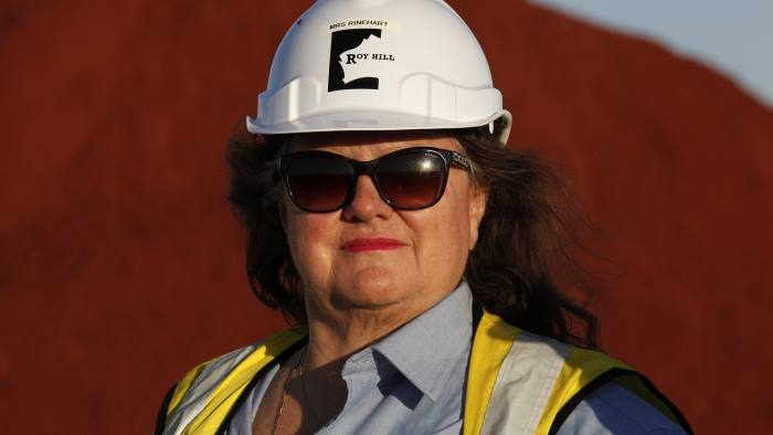 Billionaire Gina Rinehart, chairman of Hancock Prospecting Pty, stands for a photograph during a tour of the company's Roy Hill Mine operations under construction in the Pilbara region, Western Australia, on Thursday, Nov. 20, 2014. Rinehart, the Asia-Pacific's richest woman, is set to start exports in September from her new A$10 billion ($8.6 billion) iron ore mine undeterred by prices trading near five-year lows and forecast to extend losses. Photographer: Philip Gostelow/Bloomberg *** Local Caption *** Gina Rinehart