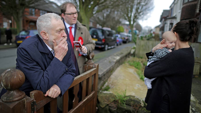 STOKE-ON-TRENT, ENGLAND - FEBRUARY 18: British Labour party leader Jeremy Corbyn meets Margot Dallimie, aged 11 months and her mother Libby Wilkinson, as he campaigns on the streets of Longton in the Stoke-On-Trent Central By-election with Labour candidate Gareth Snell on February 18, 2017 in Stoke-On-Trent, England. The Labour leader joined volunteers on the streets of Stoke to campaign for votes ahead of crucial by-elections for the party in Stoke-On-Trent and Copeland next week. (Photo by Christopher Furlong/Getty Images)