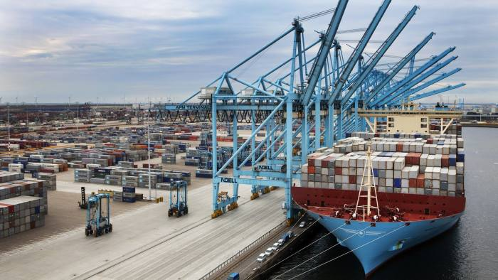 The Maersk Mc-Kinney Moller Arrives In Rotterdam Following Maiden Voyage...The Maersk Mc-Kinney Moller EEE-Class 18,000 TEU (Twenty-foot Equivalent Unit) capacity vessel, operated by A.P. Moeller-Maersk A/S, sits docked at APM Terminal at the Port of Rotterdam in this handout photograph taken on Aug. 16, 2013 and released to the media on Monday, Aug. 19, 2013. A.P. Moeller-Maersk A/S raised the earnings forecast for its container-shipping line, the world's largest, after second-quarter profit at the unit almost doubled as lower fuel prices and costs offset a drop in freight rates. Source: APM Terminals via Bloomberg EDITOR'S NOTE: NO SALES. EDITORIAL USE ONLY