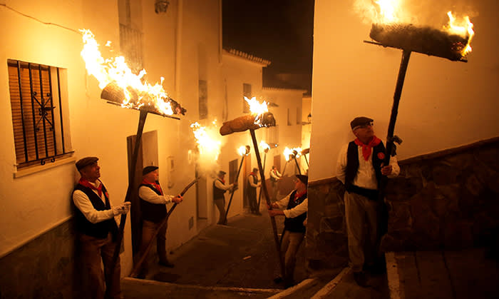 Villagers hold torches to represent light and vision during the Divina Pastora procession, as part of a festival to honour the Virgin of Los Rondeles, on the eve of St Lucia's Day, in Casarabonela, near Malaga, southern Spain December 12, 2017. REUTERS/Jon Nazca TPX IMAGES OF THE DAY
