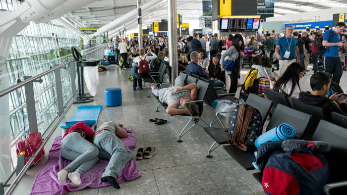 LONDON, ENGLAND - MAY 28: People sleep on a blanket at Heathrow Airport Terminal 5 on May 28, 2017 in London, England. Thousands of passengers face a second day of travel disruption after a British Airways IT failure caused the airline to cancel most of its services. (Photo by Jack Taylor/Getty Images) ***BESTPIX***