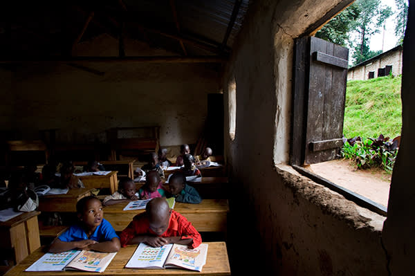 Pupils in an English class in Rwanda, where English replaced French in 2008 as the official language of instruction in schools