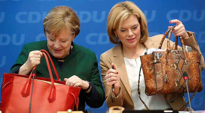 Acting Chancellor Angela Merkel and deputy leader of Christian Democratic Union Julia Kloeckner attend a party meeting at the Christian Democratic Union (CDU) headquarters in Berlin, Germany, November 27, 2017. REUTERS/Hannibal Hanschke TPX IMAGES OF THE DAY