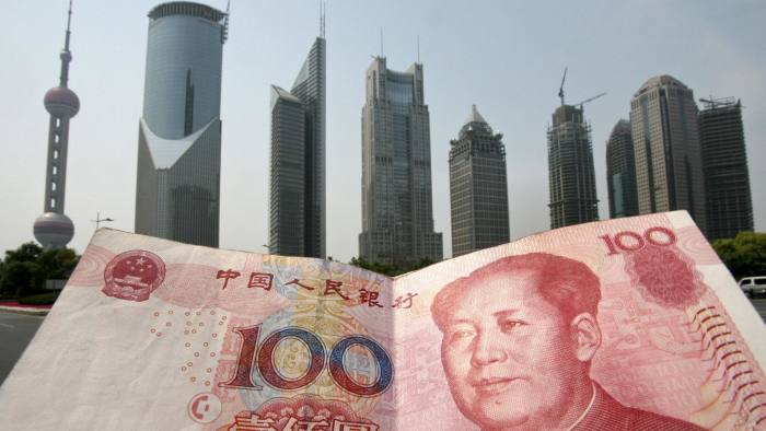 A Chinese 100 renminbi (yuan) note is held up in front of the Pudong financial district skyline in Shanghai, 21 May 2007. China recently said that it will widen its currency's trading band and raise interest rates but major partners and analysts urged Beijing to go still further to help trim huge trade imbalances. The United States and Japan reacted promptly to the announcement, urging China to use the wider band to let the yuan trade more freely and to further increase flexibility on exchange rates. AFP PHOTO/Mark RALSTON