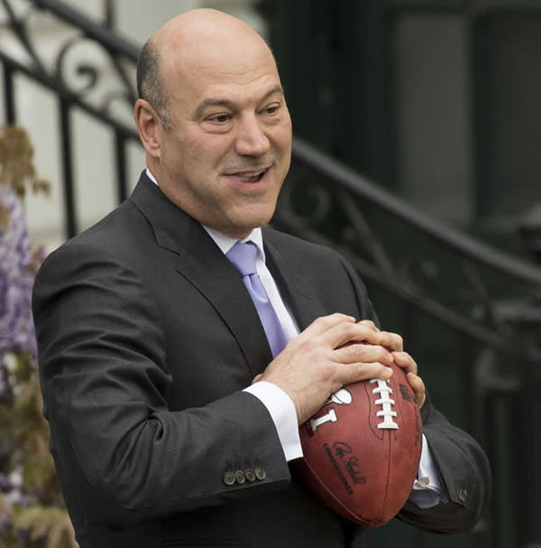 Gary Cohn holds a football after US President Donald Trump honored the New England Patriots as 2017 Super Bowl Champions on the South Lawn of the White House in Washington, DC, April 19 2017