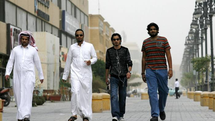 Saudi youths walk together in a business district in the Saudi capital Riyadh on February 18, 2009. Saudis have cheered King Abdullah's sweeping government shakeup as a bold step forward, after he sacked two powerful conservative religious figures and named the country's first-ever woman minister. The Saudi monarch announced the first major government shakeup on February 14 since he became king in August 2005, naming four new ministers, changing a number of top judiciary chiefs and shaking up the Ulema Council, the leading clerics whose interpretations of Islamic rules underpin daily life in the kingdom. AFP PHOTO/STR (Photo credit should read -/AFP/Getty Images)