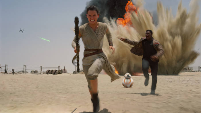 This photo provided by Disney shows Daisey Ridley as Rey, left, and John Boyega as Finn, in a scene from the new film,