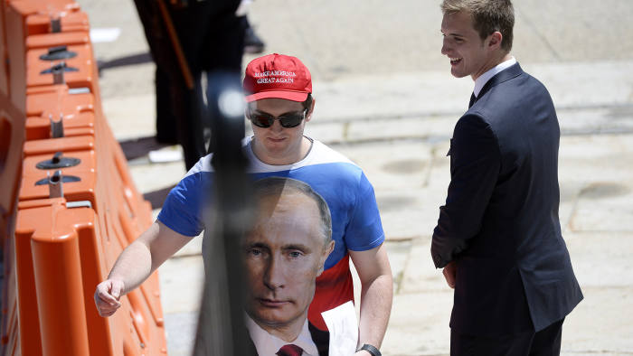 PORTLAND, ME - AUGUST 4: A Trump supporter makes his way into Merrill Auditorium sporting a Putin shirt for Trump's rally in Portland Thursday, August 4, 2016. (Photo by Shawn Patrick Ouellette/Portland Press Herald via Getty Images)