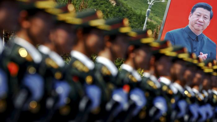 A picture of Chinese President Xi Jinping is seen behind soldiers of China's People's Liberation Army marching during a training session for a military parade to mark the 70th anniversary of the end of the World War Two, at a military base in Beijing, China, August 22, 2015. Troops from at least 10 countries including Russia and Kazakhstan will join an unprecedented military parade in Beijing next month to commemorate China's victory over Japan during World War Two, Chinese officials said. The parade on Sept. 3 will involve about 12,000 Chinese troops and 200 aircraft, Qi Rui, deputy director of the government office organizing the parade, told reporters in Beijing on Friday. REUTERS/Damir Sagolj TPX IMAGES OF THE DAY