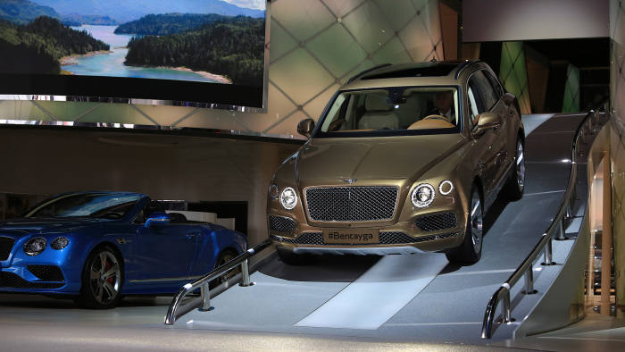 A Bentley Bentayga SUV automobile, produced by Bentley Motors Ltd., a luxury unit of Volkswagen AG (VW), is driven down a ramp at the IAA Frankfurt Motor Show in Frankfurt, Germany, on Tuesday, Sept. 15, 2015