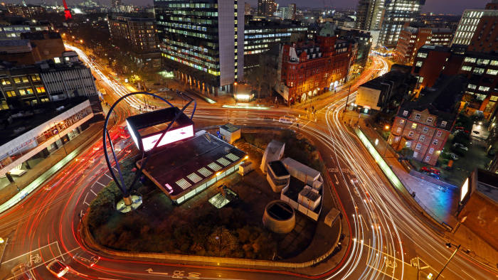 Light trails from traffic are seen as they pass around the Old Street roundabout, in the area known as London's Tech City, in London, U.K., on Tuesday, Dec. 17, 2013. The U.K government last year pledged 50 million pounds for a new London startup incubator, and hired ex-Facebook Inc. executive Joanna Shields to promote Tech City, with Google Inc., Amazon.com Inc., and Cisco Systems Inc. all having taken space in the area or planning to do so. Photographer: Chris Ratcliffe/Bloomberg