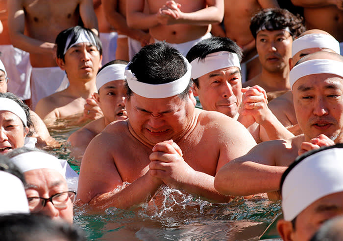 People wearing loin cloths pray as they bathe in ice-cold water in a ceremony to purify their souls and wish for good health in the new year at the Teppozu Inari shrine in Tokyo, Japan, January 14, 2018. REUTERS/Kim Kyung-Hoon TPX IMAGES OF THE DAY