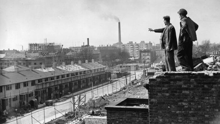 A slum clearance operation in Poplar, East London, 19th April 1951. The workers are standing on the ruins of Trinity Church, largely destroyed in the Blitz. (Photo by Topical Press Agency/Getty Images)