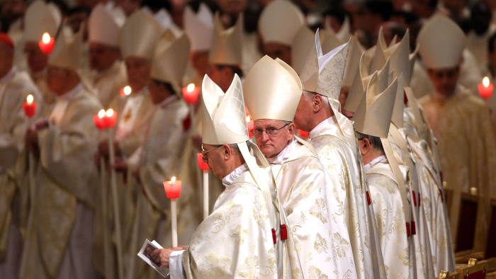 Cardinals attend the Easter vigil mass given by Pope Francis at St Peter's Basilica in Vatican City