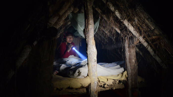 In this photograph taken on February 3, 2017, Nepalese woman Pabitra Giri prepares to sleep in a Chhaupadi hut during her menstruation period in Surkhet District, some 520km west of Kathmandu.