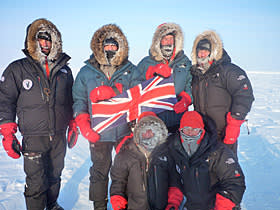Jim Ratcliffe (standing second from right) at the North Pole with his sons Sam (on his right) and George (in front of them)