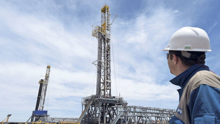 Argentinian oil company YPF's drilling chief Martin Costa observes two oil drilling rigs at his charge in Vaca Muerta Shale oil reservoir at Loma Campana, in the Patagonian province of Neuquen, some 1180 Km south-west of Buenos Aires, Argentina on December 4, 2014