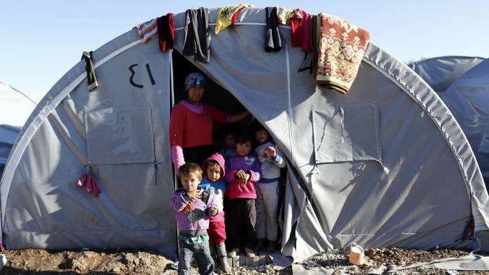 epa04455582 Syrian refugee family wait by their tent in a refugee camp in the Suruc district, Sanliurfa, Turkey, 21 October 2014. According to news reports, the People's Protection Units (YPG) fighters have made gains against IS militants in their defence of the besieged town of Kobane, following over 50 airstrikes around the town carried out by the international anti-IS coalition which according to the Pentagon have killed hundreds of IS militants in the operation now named Inherent Resolve. Kurdish fighters defending the northern Syrian town of Kobane from the 'Islamic State' confirmed that they had safely received weapons, ammunition and medical supplies dropped by the US military. EPA/SEDAT SUNA