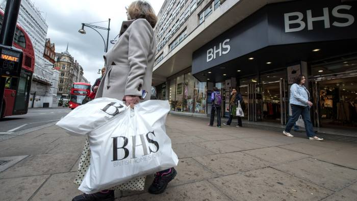 LONDON, ENGLAND - APRIL 25: A woman walks out of the British Home Stores on Oxford Street with bags of shopping on April 25, 2016 in London, England. High street retailer British Home Stores (BHS) is filing for administration today, threatening almost 11,000 jobs. BHS currently has 164 stores across the UK since it opened its first store in Brixton, London in 1928. (Photo by Chris Ratcliffe/Getty Images)