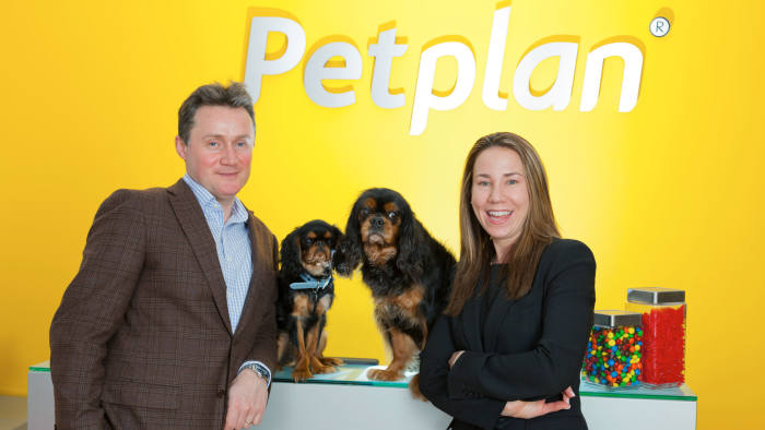 Chris and Natasha Ashton of PetPlan with their dogs Montgomery and Wellington photographed at their office in Philadelphia,