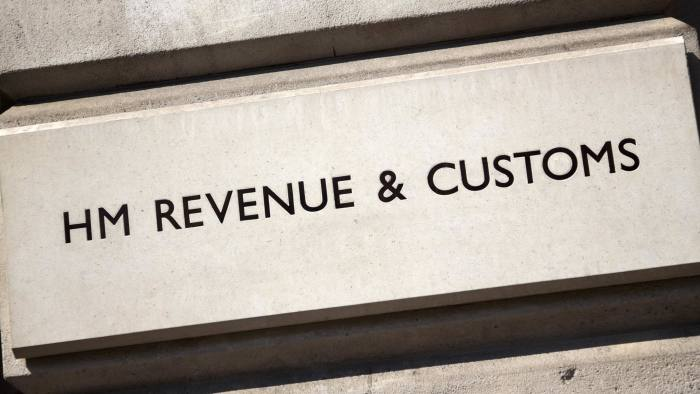 London, England - April 25, 2011: A HM Revenue & Customs sign incised into the stone wall outside their offices in Whitehall, City of Westminster, London. HMRC (as HM Revenue & Customs is usually known) was formed in 2005 by merging the Inland Revenue with Her Majesty's Customs & Excise and is a non-ministerial Government department. The headquarters are at 100 Parliament Street, Whitehall, opposite to Parliament Square.