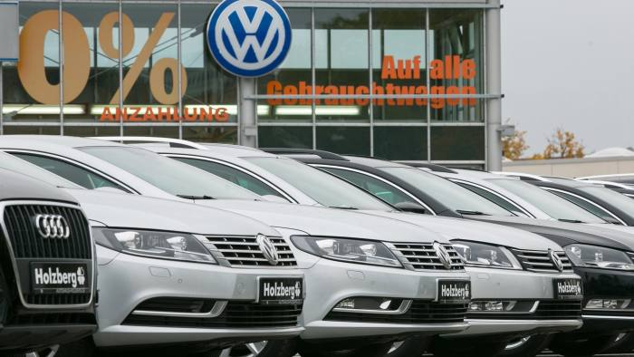 VW slumps to first net loss in 15 years and warns of scandal toll